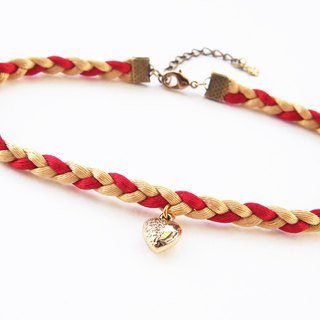 Red gold braided choker / necklace with tiny gold heart charm.
