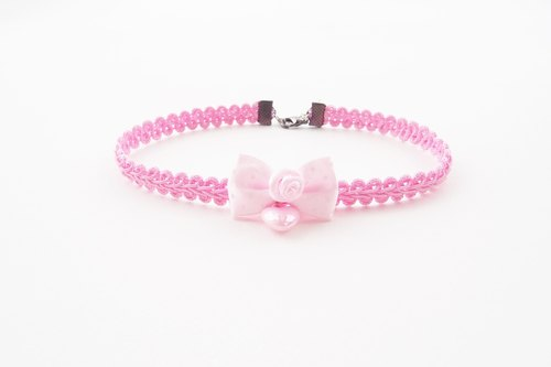 Pink choker / necklace with pink bow and pink heart.