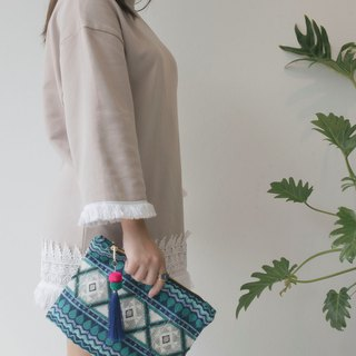 Patong Handmade Clutch bag With Pom Pom Chain