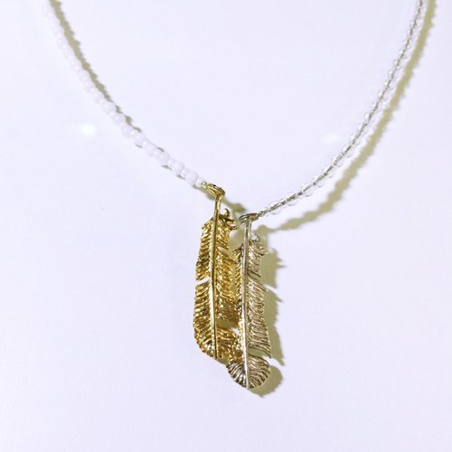 Snuggled feather pendant