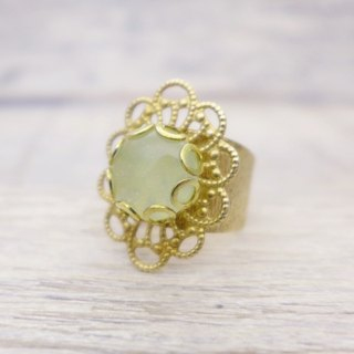 Brass and glass with shiny fine powder, classical oval shape ring, Pale milky green