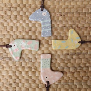 Handmade ceramic necklace inspired by Dinosaur in pastel.