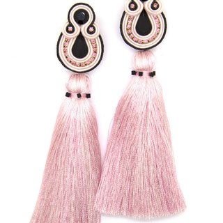 Tassel earrings in combination of light pink and black colors.