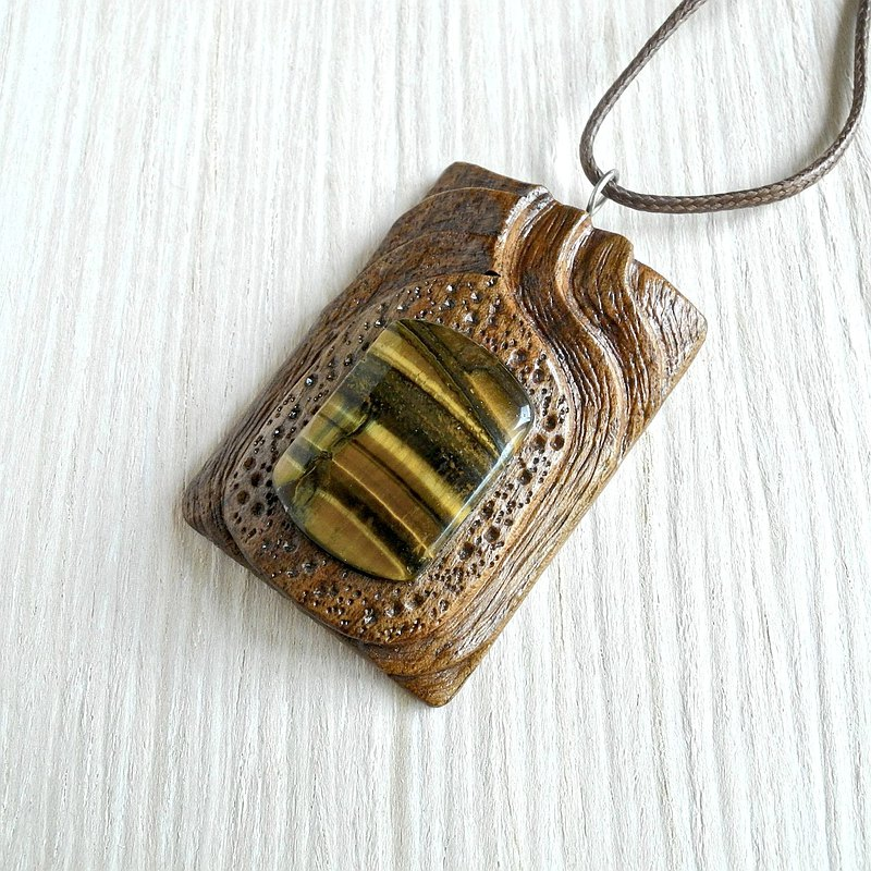 Wooden carved pendant with tiger-eye