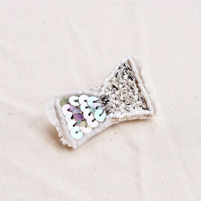 White brooch j
