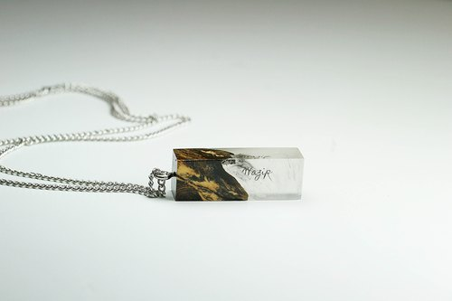 Glow in the dark with Your Signature x Darkness necklace (from Burl wood)