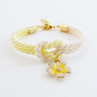 Light yellow and cream knot bracelet with flower charm