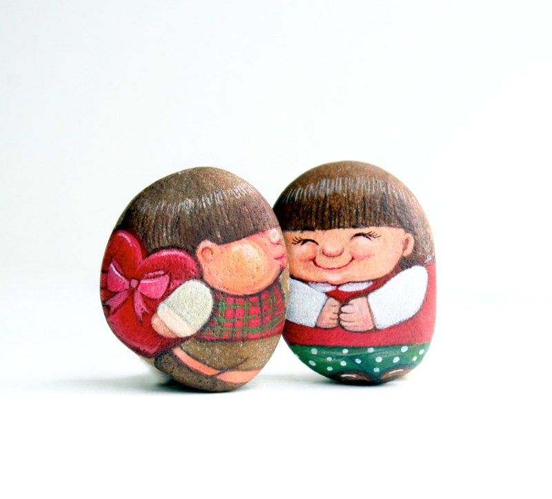 Love couples stone painting.