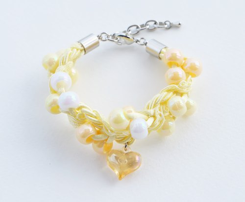 Yellow beaded rope bracelet with yellow heart charm