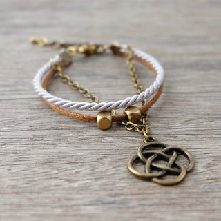 Knot charm bracelet in brown